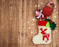 Christmas decorations and sock on wood background. Beautiful Chr Stock Photography