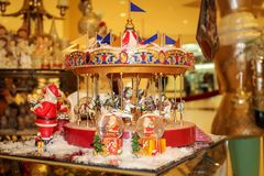 Christmas decorations and souvenirs. Musical Christmas carousel. Warm toned photo. New year concept royalty free stock images