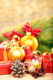 Christmas decorations with space for text on golden blurry light Royalty Free Stock Photos