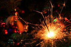 Christmas decorations and sparkler Stock Image