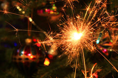 Christmas decorations and sparkler Royalty Free Stock Photo