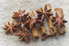 Christmas decorations with spices. On a white snow background Royalty Free Stock Photos