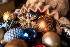 Christmas decorations spilled from canvas bag on a table Stock Photo