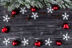 Christmas decorations, spruce branches on dark wooden background Royalty Free Stock Photos