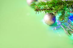 Christmas decorations. With spruce branches and lights on green background Stock Photo