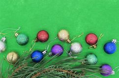 Christmas decorations with spruce twig on a green textured backg Stock Photography