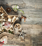 Christmas decorations in star shaped box on wooden Stock Photo
