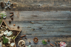 Christmas decorations in star shaped box on wooden Stock Photos