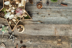 Christmas decorations in star shaped box on wooden Stock Image
