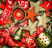 Christmas decorations stars, red ribbons and burning candle Royalty Free Stock Image