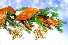 Christmas Decorations - stars, ribbon, con on fir Stock Photos