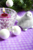 Christmas decorations. Christmas still-life with pine, white balls and a bird stock photo
