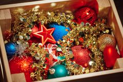Christmas decorations stored in wooden box Royalty Free Stock Photo