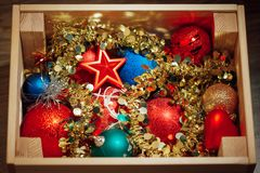 Christmas decorations stored in wooden box Stock Photography