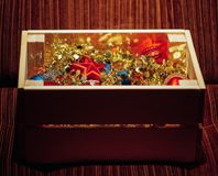 Christmas decorations stored in wooden box. Closeup view Royalty Free Stock Photo