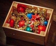 Christmas decorations stored in wooden box Stock Photos