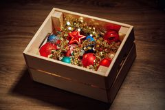 Christmas decorations stored in wooden box. Closeup view Royalty Free Stock Image