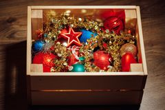 Christmas decorations stored in wooden box. Closeup view Royalty Free Stock Images