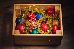Christmas decorations stored in wooden box. Closeup view Stock Photo