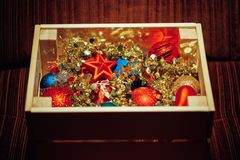 Christmas decorations stored in wooden box. Closeup view Stock Photos
