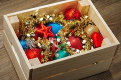 Christmas decorations stored in wooden box. Closeup view Stock Photography