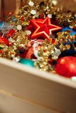 Christmas decorations stored in wooden box Stock Image