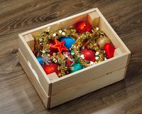 Christmas decorations stored in wooden box. Closeup view Stock Image