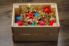 Christmas decorations stored in wooden box. Closeup view Royalty Free Stock Photos