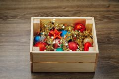 Christmas decorations stored in wooden box. Closeup view Stock Images