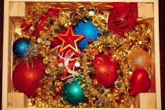 Christmas decorations stored in wooden box Royalty Free Stock Images
