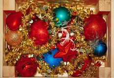 Christmas decorations stored in wooden box Royalty Free Stock Image