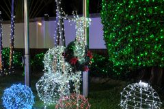 Christmas decorations on the street. A deer made from glowing Christmas lights. Festive decor royalty free stock photo