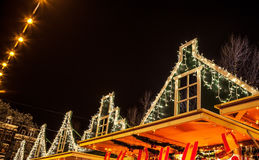 Christmas decorations on streets of night Amsterdam. Stock Images