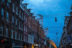 Christmas decorations on streets of night Amsterdam. Stock Photography