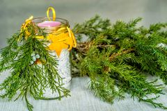 Christmas hand made candle craft on the table with a fir tree spruce Royalty Free Stock Images