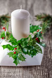 Christmas Decorations on a table. Christmas symbols including Candle on a wooden table Royalty Free Stock Photo