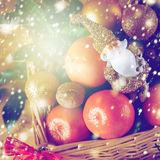 Christmas Decorations with Tangerine and Toy Santa Stock Images