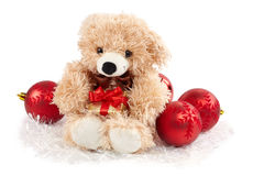 Christmas decorations and teddy holding a gift Stock Photo
