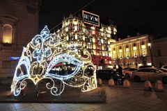 Christmas decorations on Theater Square in Moscow. Huge mask. Christmas decorations on Theater Square in Moscow, popular landmark. Huge mask. Bolshoi Theater Royalty Free Stock Images
