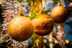 Christmas Decorations. Three baubes hanging in a Christmas tree stock photography