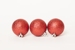 Christmas decorations. Three red Christmas ball on a white background Stock Photo