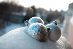 Christmas decorations three silver balls in the snow in winter. Christmas tree ornaments snowball fight holiday silver Winter white cold snow stock photos