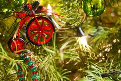 Christmas Decorations. A toy bicycle decoration hangs from a Christmas tree Stock Images