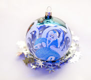 Christmas decorations. Christmas toy in the shape of a ball with a picture of Snow Maiden Stock Images