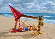 Christmas decorations and toys on the beach Royalty Free Stock Images