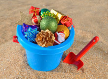 Christmas decorations and toys on the beach sand Stock Image