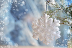 Christmas decorations - toys white snowflakes on silver material Royalty Free Stock Image