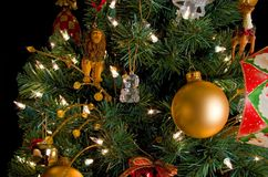 Christmas decorations on a tree. Christmas decorations embellish a tree top Royalty Free Stock Photos