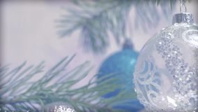 Christmas decorations with Christmas tree and blinking lights garlands stock footage
