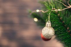 Christmas decorations on the tree with blurred background stock image